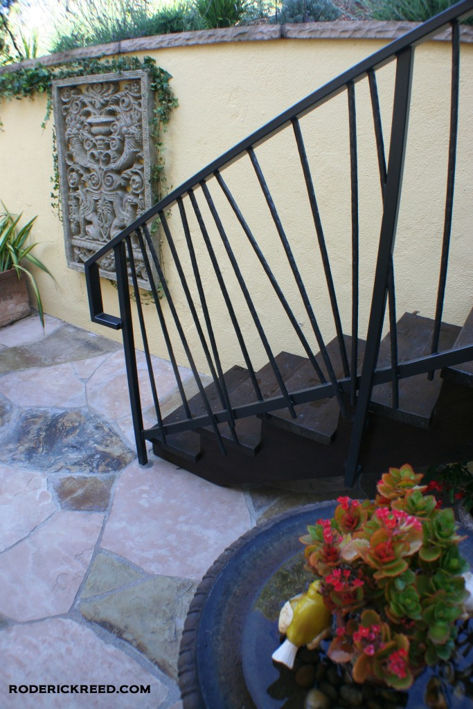 Courtyard design. Stair railings made in a random sticks design by REEDesign Interiors. Laguna Beach